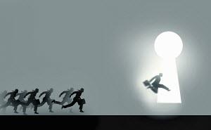 Businessmen running in race to enter illuminated keyhole