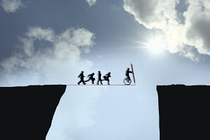 Business people following businessman bridging the gap with pencil line tightrope between cliffs