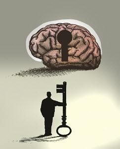Man holding large key to keyhole in brain