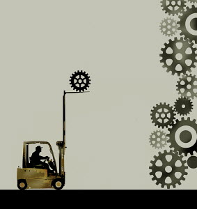 Man adding cog to pile using forklift truck