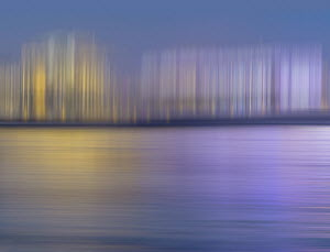 Abstract pattern of blurred buildings on waterfront