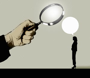 Magnifying glass examining what businesswoman is saying