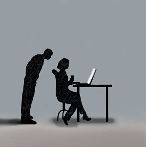 Man spying on woman working on computer