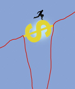 Businessman bridging the gap in line graph with dollar sign