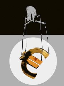 Hand manipulating euro symbol puppet on strings