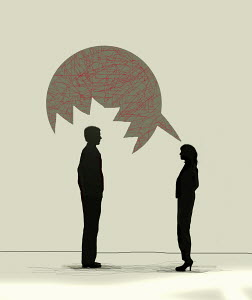 Woman talking to man with speech bubble with aggressive teeth