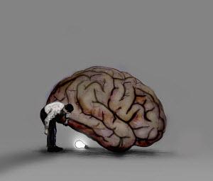 Man finding illuminated light bulb underneath large brain