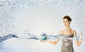 Woman holding globe surrounded by water
