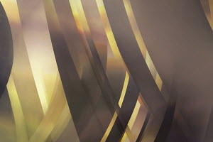 Abstract brown and gold overlapping curved stripe pattern