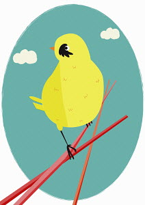 Yellow bird perching on twig