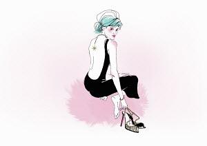 Glamorous kneeling woman holding high heels