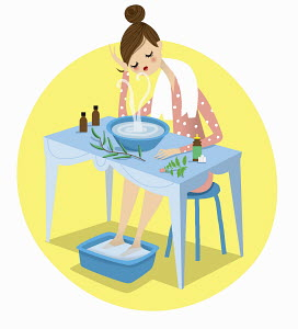 Woman with cold soaking feet and using herbal remedy decongestant