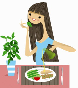 Woman smelling fresh herb with healthy meal
