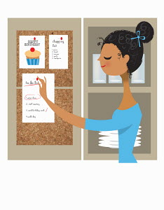 Organized woman pinning to do list to pin board
