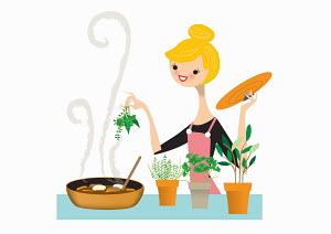 Woman adding fresh herbs to pan
