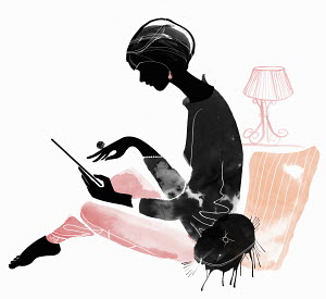 Elegant woman using digital tablet in living room