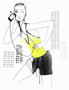Portrait of fit woman with mp3 player listening to music on headphones
