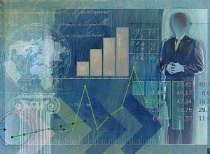 Businessman, globe, data, graphs and financial figures
