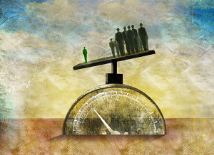 Businessman standing out from the crowd on scales and weighing more than large group