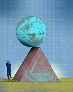 Man looking at globe teetering on edge of United States pyramid