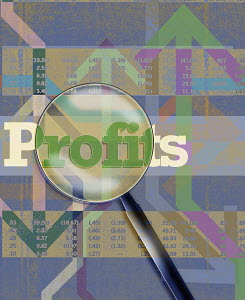 Magnifying glass over profits, financial figures and arrows