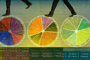 Businessmen walking on top of multicolored pie charts and financial figures