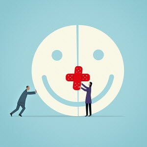 Business people bandaging enormous smiley face
