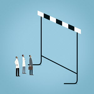 Scientists and businessman looking up at large hurdle