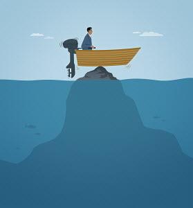 Businessman stranded in motorboat on pinnacle of rock