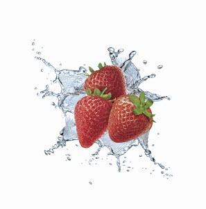 Water splashing around strawberries