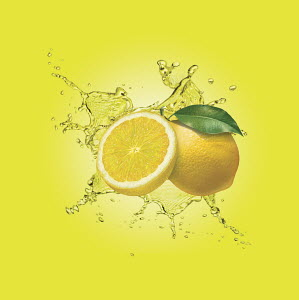 Water splashing around lemons
