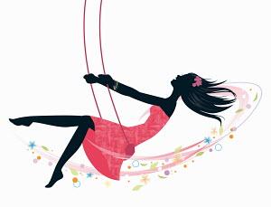 Happy carefree woman on swing