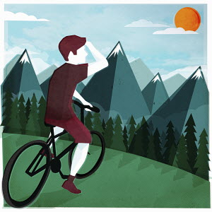 Young man on bicycle looking ahead at sun over mountain range