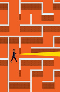 Businessman with torch lost in brick wall maze