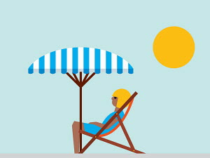 Woman relaxing in deckchair under beach umbrella