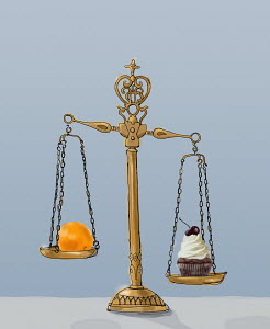 Cupcake and orange on opposite ends of weighing scales