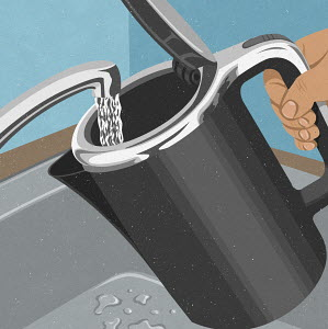 Hand filling kettle with water from faucet
