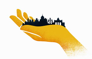Hand holding skyline of European urban architecture