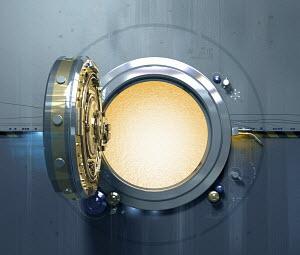 Open vault door with glowing light inside