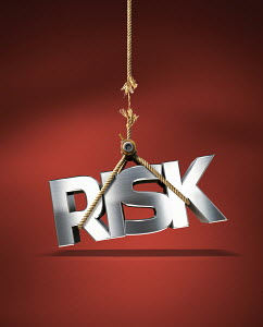 "Frayed rope holding ""Risk"" sign"