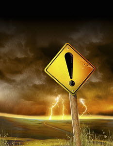 Hazard warning exclamation point on road sign in front of lightning storm