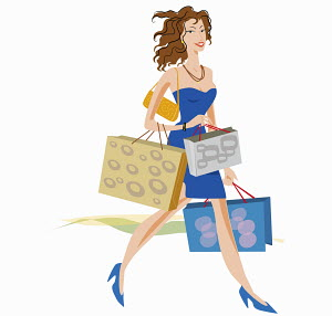 Glamorous woman carrying lots of shopping bags