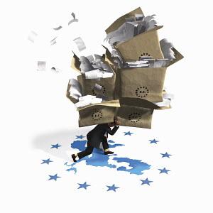 Businessman struggling under the weight of European Union bureaucracy