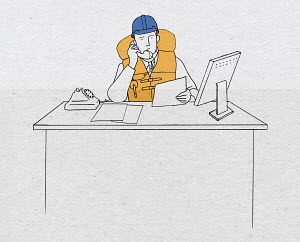 Businessman on phone wearing hard hat and life vest at desk