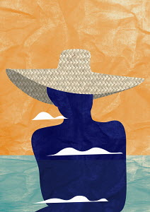 Silhouette of woman wearing straw sun hat at seaside