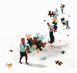 Business people holding separate disconnected jigsaw puzzle