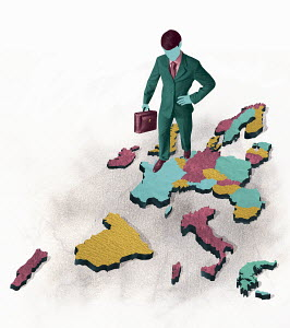 Businessman standing on disintegrating map of Europe