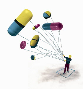 Man flying pills and medicine capsules as kite