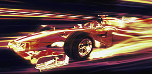 Formula one racing car moving at speed at night