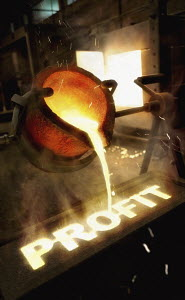 Molten metal pouring into mold of the word 'profit'